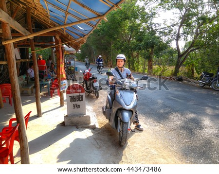 Ha Tien Town, Kien Giang province, VietNam - April 30, 2016 : woman resting after a long trip picnic by motorcycle