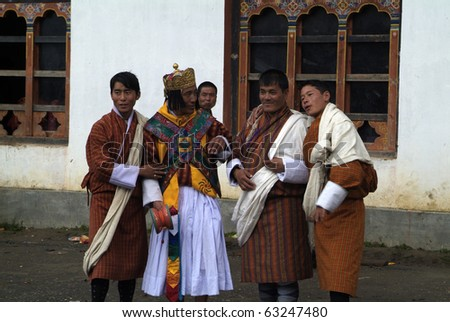 HAA, BHUTAN - SEPTEMBER 21: unknown spectators and dancers with masks at the religous festival named Tshechu in the White Temple (Karpho Lhakhang) on September 21, 2007 in Haa, Bhutan