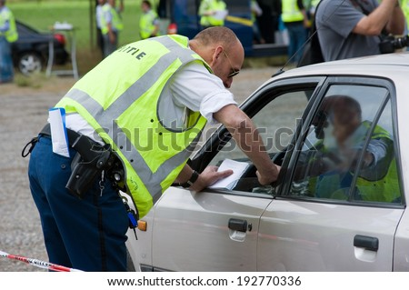 HAAKSBERGEN, NETHERLANDS - JUNE 09: A policeman is talking with a car driver during a massive traffic control, june 09, 2011 in the Netherlands - stock photo