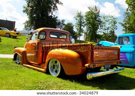 HAAPSALU, ESTONIA - JULY 18: American Beauty Car Show, showing orange 1948 Chevrolet Pickup, rear view on July 18, 2009 in Haapsalu, Estonia