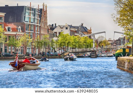 HAARLEM, NETHERLANDS - APR 30, 2017 : Canal with boats in Spring. Typical Dutch architecture. View from the boat level.