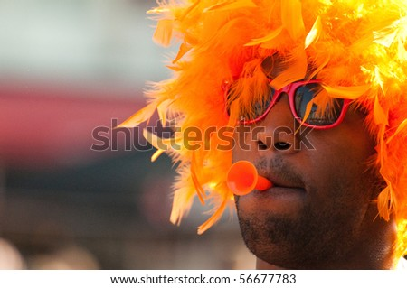 HAARLEM, NETHERLANDS - JULY 6: Netherlands fan celebrates as his football team went into the final of 2010 World Cup July 6,2010  in Haarlem, Netherlands. - stock photo
