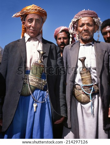 HABBAH,YEMEN- APRIL 23, 2011; Two old men in djellaba and with the traditional jambiya. Every man in Yemen wears a knife called jambiya.April 23,2011 Habbah,Yemen - stock photo