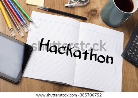 Hackathon - Note Pad With Text On Wooden Table - with office  tools - stock photo