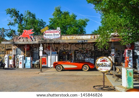 HACKBERRY, AZ - MAY 15: A classic corvette outside the antique Hackberry General Store  on May 15, 2013 recalls the atmosphere of the 1950s.  - stock photo