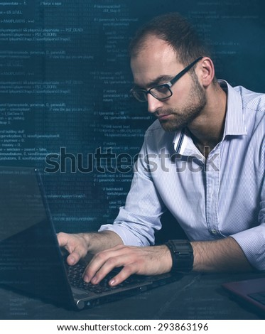 hacker at work with graphic user interface around - stock photo