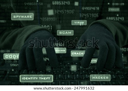 Hacker hands wearing gloves typing on keyboard to steal user ID - stock photo