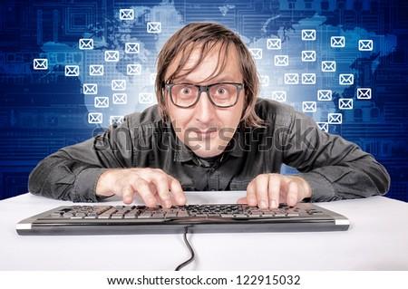 Hacker in Action sending emails worldwide - stock photo