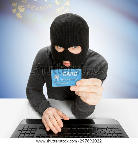 Hacker in black mask with USA state flag - Nevada