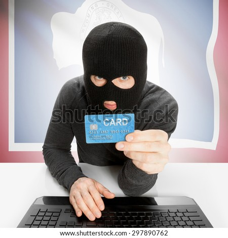 Hacker in black mask with USA state flag - Wyoming
