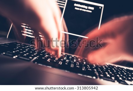 Hacker in Work. High Speed Computer Keyboard Typing by Professional Hacker. Hacking the Internet Photo Concept. - stock photo