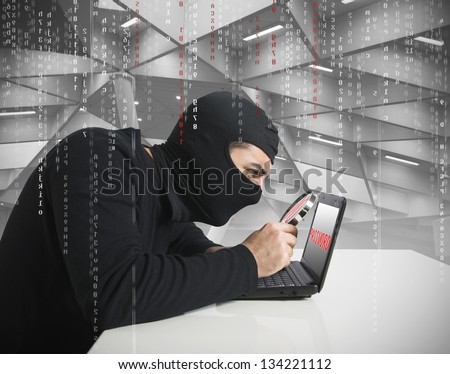 Hacker look for password in a laptop - stock photo