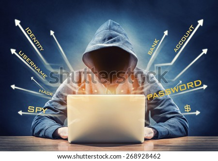 hacker on a computer - stock photo