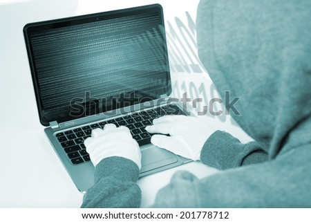 hacker on computer with white gloves - stock photo