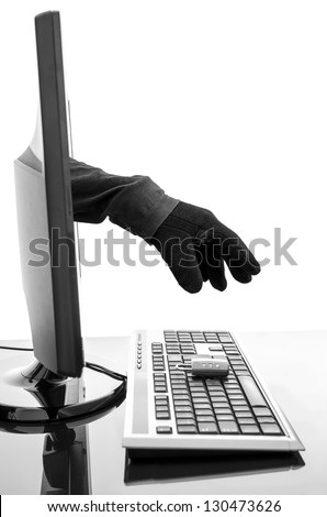 Hacker's gloved hand stealing padlock through a computer screen. Concept of internet security. - stock photo