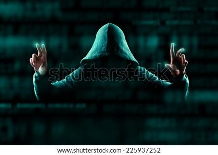 Hacker sorting data around him - stock photo