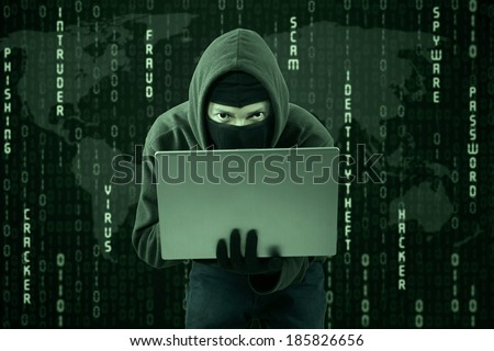 Hacker typing on a laptop with binary code background - stock photo