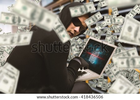 Hacker using laptop to steal identity against server room at office - stock photo