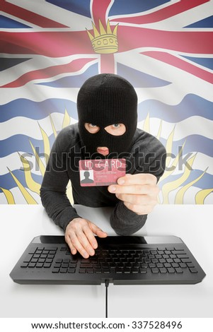 Hacker with ID card in hand and Canadian province flag on background - British Columbia - stock photo