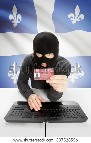 Hacker with ID card in hand and Canadian province flag on background - Quebec - stock photo