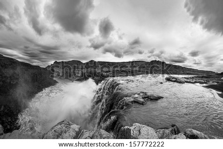 Hafragilsfoss is the very powerful waterfall on Iceland not far from its bigger brother Dettifoss. It is located in Jokulsargljufur National Park, northeasten Iceland on the river Jokulsa a Fjollum. - stock photo