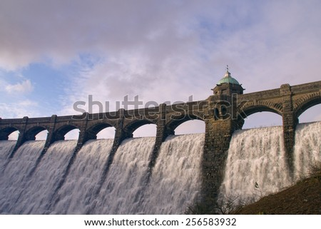 Hafren Dam in Mid-Wales with water overflowing  - stock photo