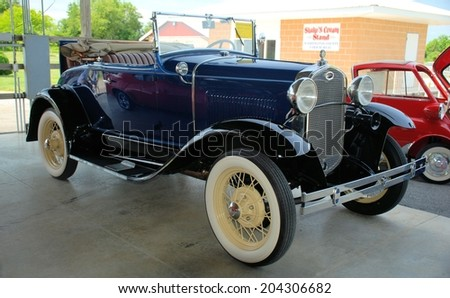 HAGERSTOWN, MD - JUNE 28, 2014:  Image of a vintage car, proceeds from the car show benefit the transportation museum at the Washington County Agricultural Education Center.