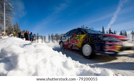 HAGFORS, SWEDEN - FEB 13: Dani Sordo driving his Citroen WRC in the forests of the WRC event Rally Sweden 2010 in Hagfors, Sweden on February 13, 2010 - stock photo