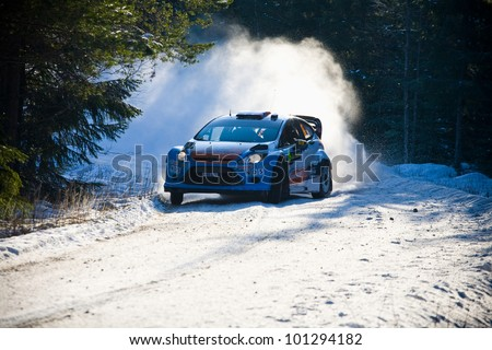 HAGFORS, SWEDEN - FEB 09: Mads Ostberg in his Ford Fiesta WRC during the Shakedown stage in  Rally Sweden 2012 in Hagfors , Sweden on Feb 9, 2012 - stock photo