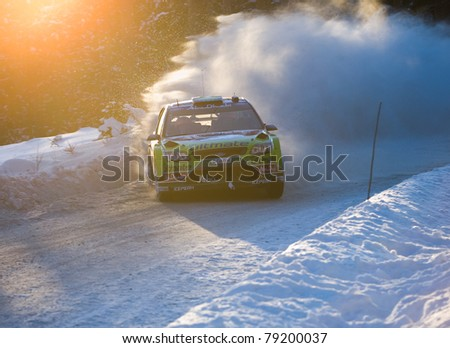 HAGFORS, SWEDEN - FEB 13: Mikko Hirvonen drifting his Ford Focus WRC rally car during Rally Sweden 2010 in Hagfors, Sweden on February 13, 2010 - stock photo