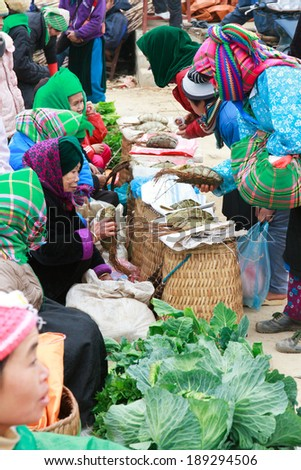 HAGIANG, VIETNAM, FEBRUARY 16: Unidentified ethnic minority women in a traditional market on February 16, 2014 in HaGiang, Vietnam. Ha Giang is a northernmost province in Vietnam