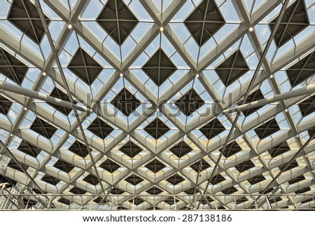 HAGUE, NETHERLANDS-AUGUST 01, 2014: Transparent ceiling of The Hague Central railway station or Den Haag Centraal. - stock photo
