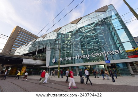 HAGUE - SEPTEMBER 19: Busy commuters in front of Den haag Central railway station, taken on September 19, 2014 in Hague, Netherlands - stock photo
