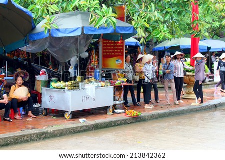 HAI DUONG, VIETNAM, AUGUST, 29: group of people sales goods in market on August, 29, 2014 in Hai Duong, Vietnam. - stock photo
