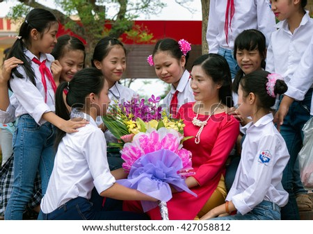 HAI DUONG, VIETNAM, May 7, 2016 young teacher (anonymity), are students offer flowers, birthday