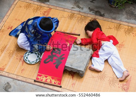 HAI DUONG, Vietnam, September 2, 2016 two young children, dressed in traditional costumes. Favorite write out, word drought