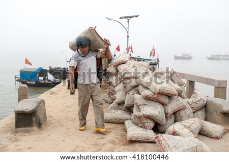 HAI PHONG, VIETNAM April 12 2016 Fishermen are transporting construction materials on Hon Dau Island.this is one of the most beautiful island and there are many tourists in Hai Phong,VIetnam