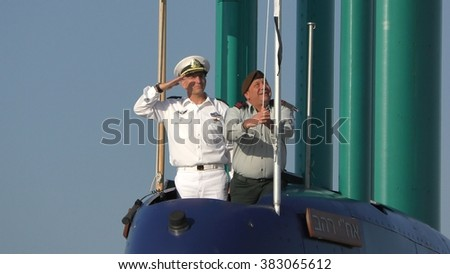HAIFA, ISRAEL - JANUARY 12, 2016: Chief of Staff Eisenkot, Commander of the Israeli Navy Rothberg, raise and salute the flag during ceremonial welcome of Rahav Submarine - stock photo