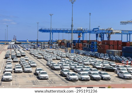 Haifa, Israel - July 10, 2015: Rows of new cars covered in protective white sheet parked in Haifa's port platform.