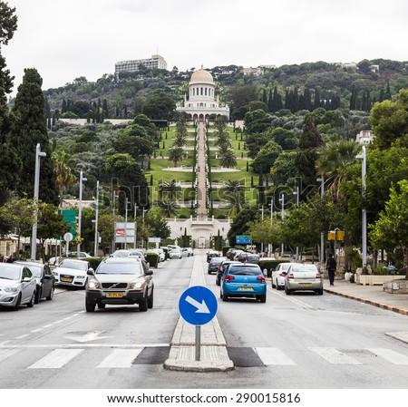 HAIFA, ISRAEL - OCTOBER 22, 2014: View to Bahai Gardens from Sderot Ben Gurion (boulevard) near Unesco square. Shrine of Bahai and Gardens is Haifaâ??s prime attraction - stock photo