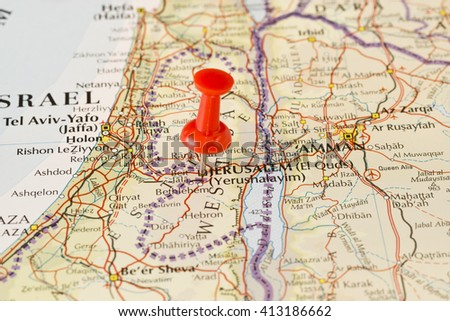 Haifa marked on map with red pushpin. Selective focus on the word Jerusalem and the pushpin. Pin is in an angle. Midground is sharp while foreground and background is blurry. - stock photo