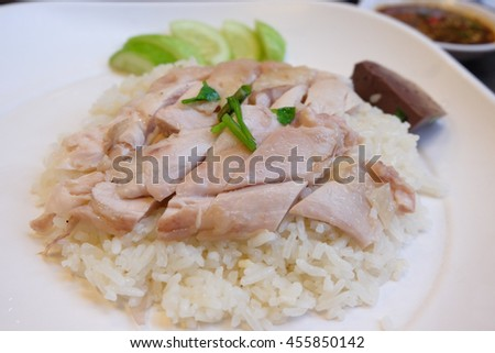 Hainanese chicken rice, steamed chicken and white rice