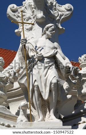 Hainburg an der Donau - Saint John the Baptist detail from baroque column dedicated to hl. Mary - stock photo