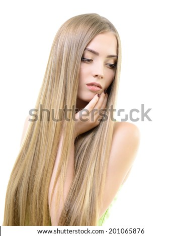 Hair. Beautiful bond girl with healthy long hair. Haircare and hairstyle.