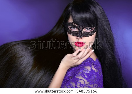 Hair. Beautiful Brunette Girl. Healthy Long glossy Hairstyle. Red lips. Beauty make-up. Mask. Manicured nail. Fashion art photo of young woman isolated on purple dark background. - stock photo