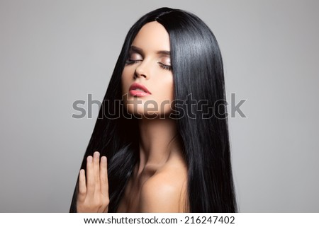 Hair. Beautiful Brunette Girl. Healthy Long Hair. Beauty Model Woman. Hairstyle  - stock photo