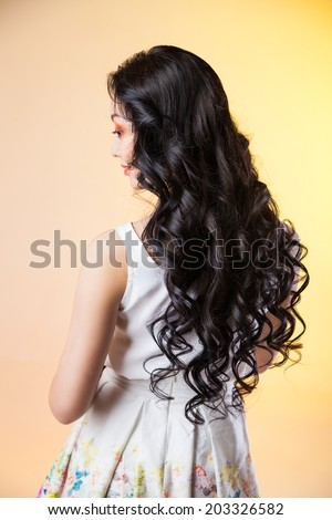 Hair. Beautiful Brunette Girl. Healthy Long Hair. Hairstyle