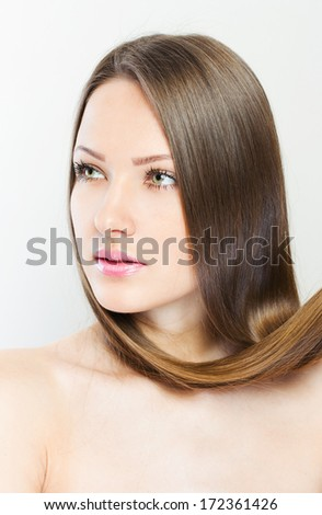 Hair. Beautiful Brunette Girl. Healthy Long Hair. Hairstyle. Hair care