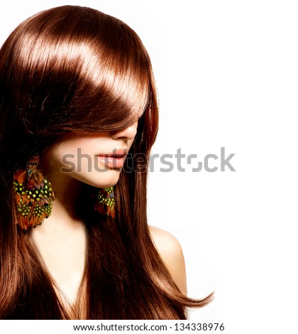 Hair. Beautiful Brunette Girl with Healthy Long Brown Hair. Beauty Model Woman Portrait isolated on White Background. Hairstyle. Stylish Haircut. Fringe. Glossy Smooth Fashion Hair. Extensions - stock photo