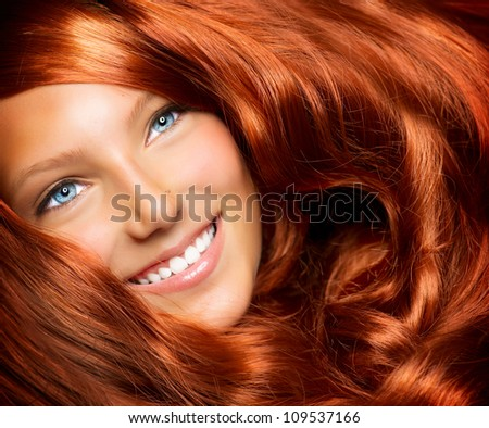 Hair. Beauty With Healthy Long Red Curly Hair. Extension - stock photo
